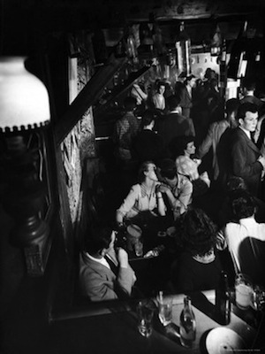 gjon-mili-inside-a-crowded-pub-with-couple-kissing-st-germain-des-pres