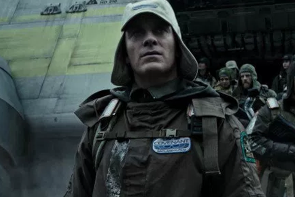 Michael Fassbender in a cap and exploration gear, heading out from a lander in the science fiction film Alien Covenant