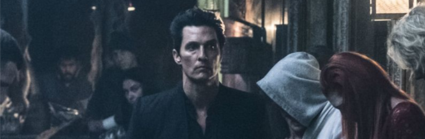 Matthew McConaughey walking towards the camera looking very grim and wearing all black. This is a still from the movie the Dark Tower.